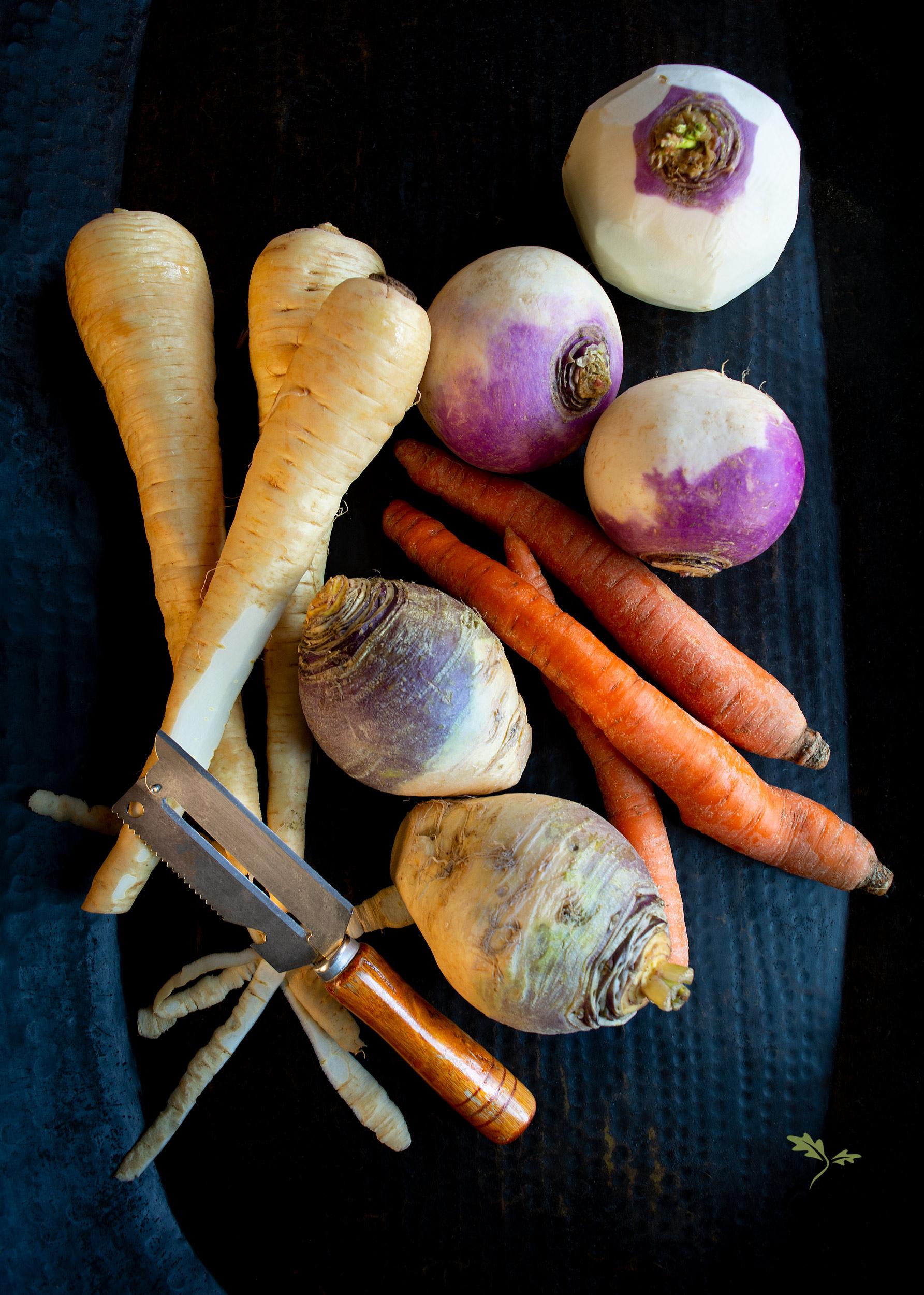 Peeling root vegetables for roasting.